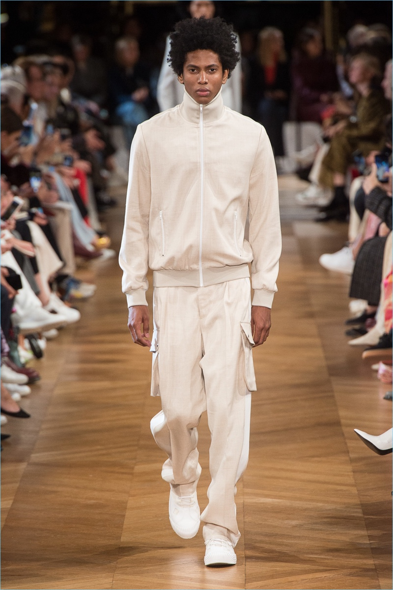 Rafael Mieses sports a chic take on the tracksuit from Stella McCartney's spring-summer 2019 men's collection.