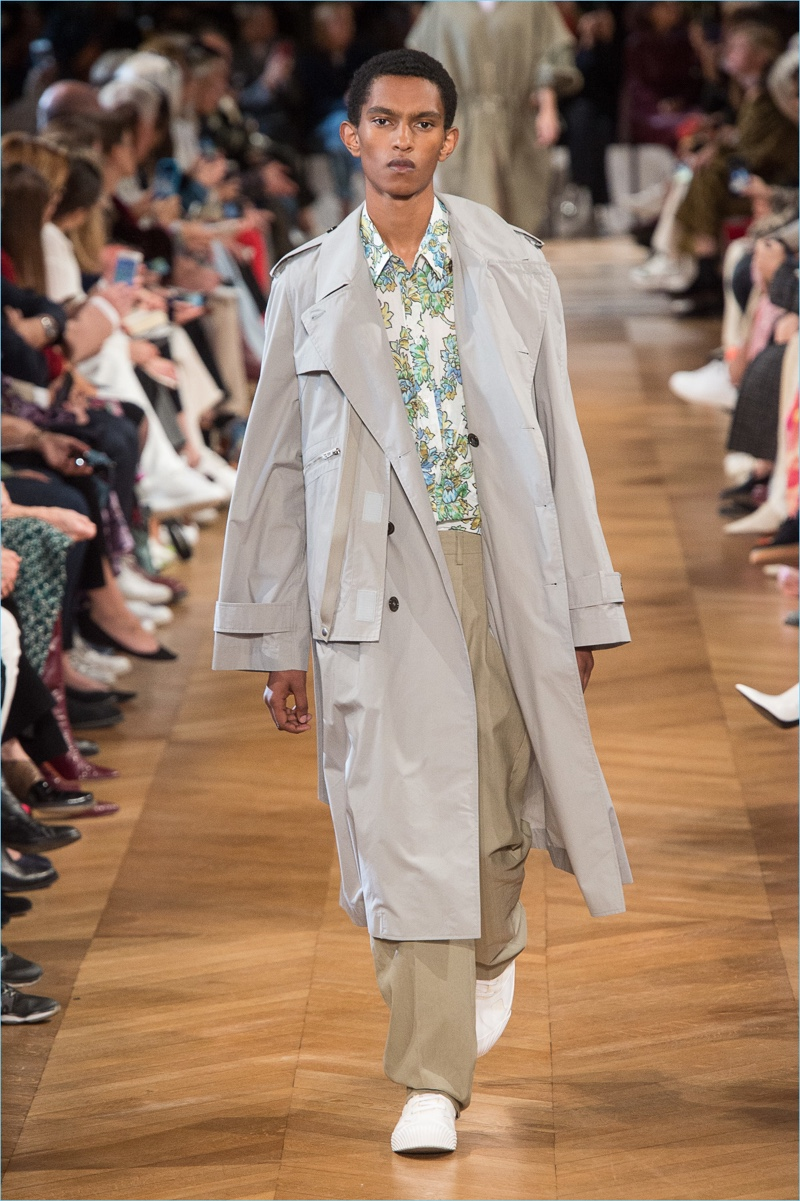 Matthew Petersen sports an oversized trench from Stella McCartney's spring-summer 2019 men's collection.