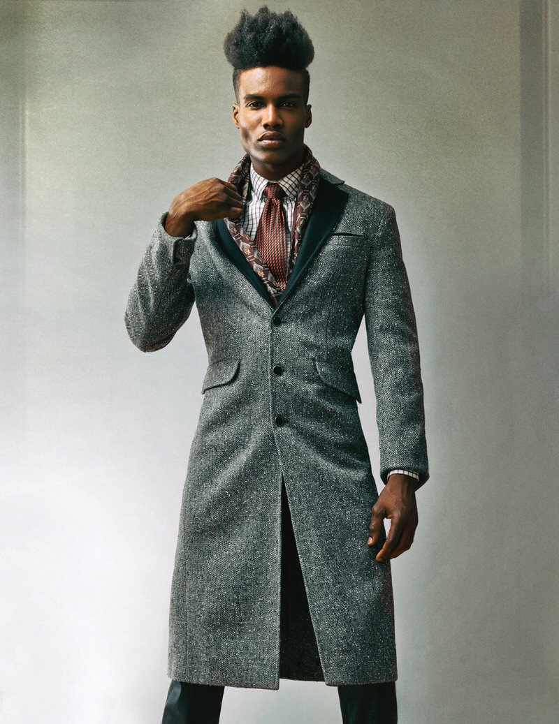 Roland Barziliar Jr wears vintage accessories, pants Diesel, coat and shirt Shelli Oh.