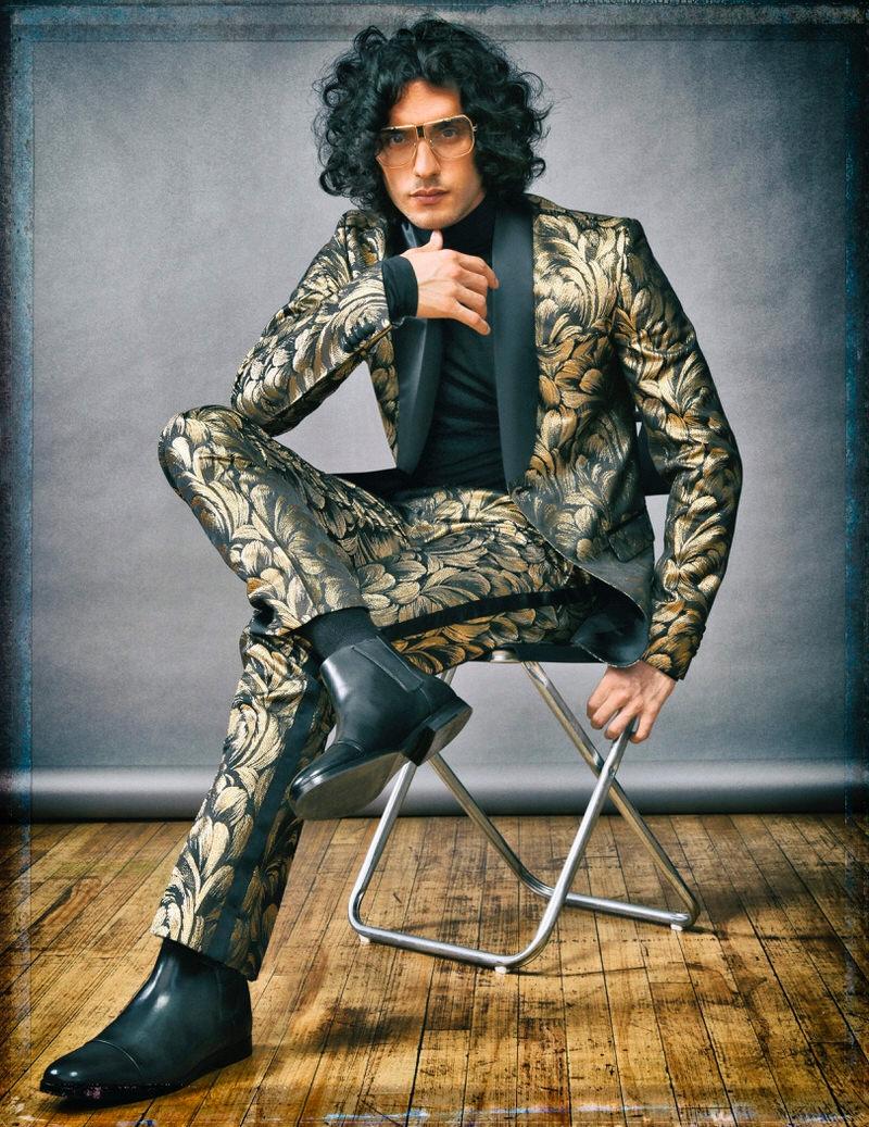 Reza Zohouri wears vintage glasses Dior, boots Calvin Klein, turtleneck and suit Rhowan James.