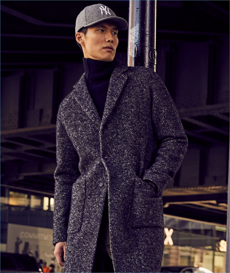 Dae Na sports an Italian wool bouclé herringbone topcoat from Todd Snyder.