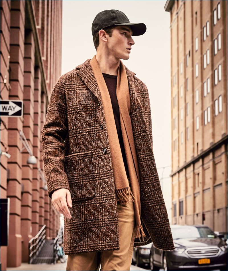 British model Oli Lacey wears a Todd Snyder Italian wool bouclé Glen Plaid topcoat in brown.