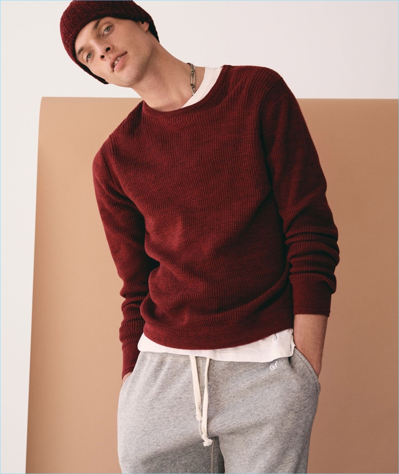 Playing it casual, Rocky Harwood sports a Todd Snyder merino waffle crewneck sweater in red marl.