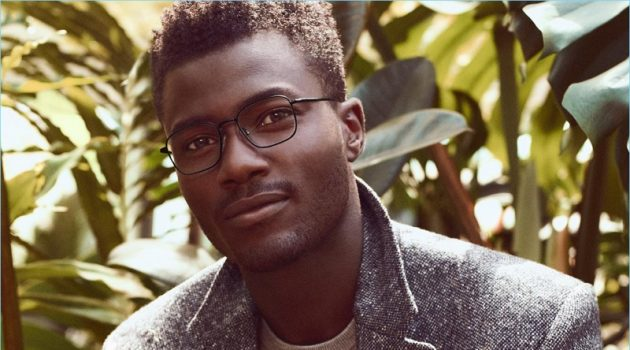 Remi Alade-Chester dons Warby Parker's Stanley glasses in brushed ink.