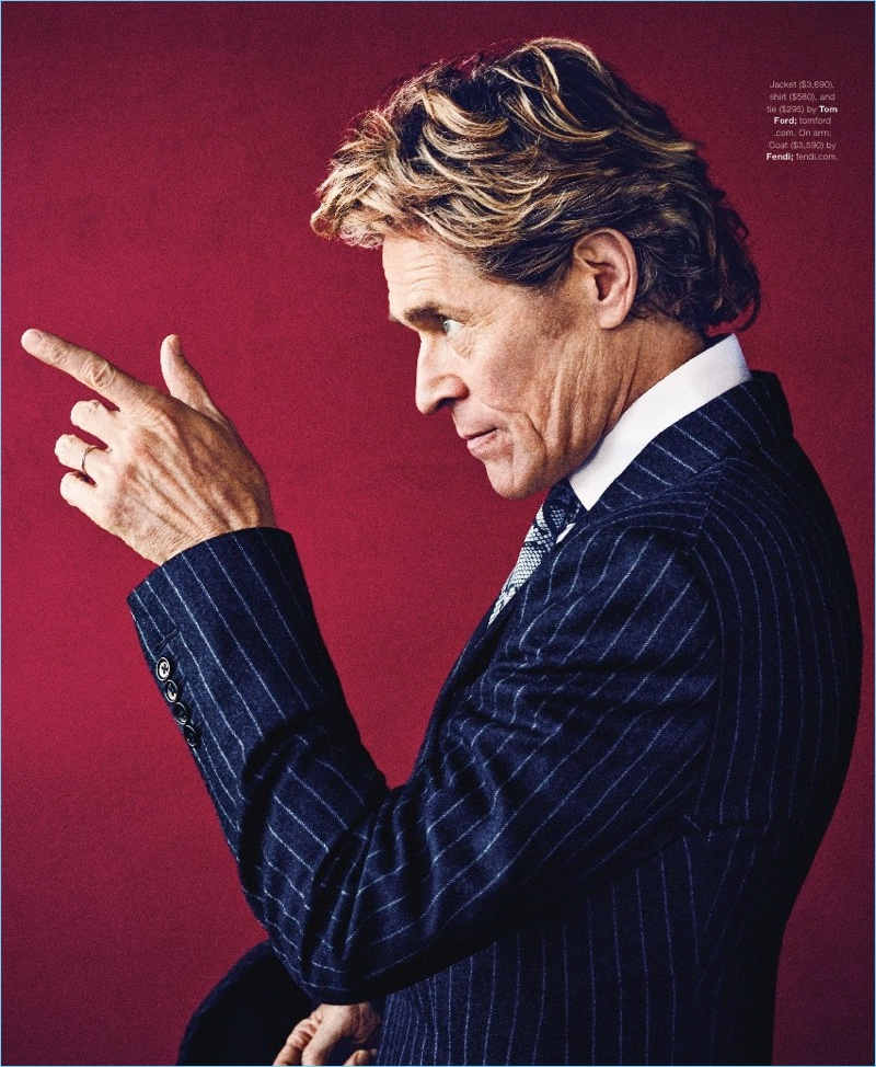Actor Willem Dafoe wears a jacket, shirt, and tie by Tom Ford.