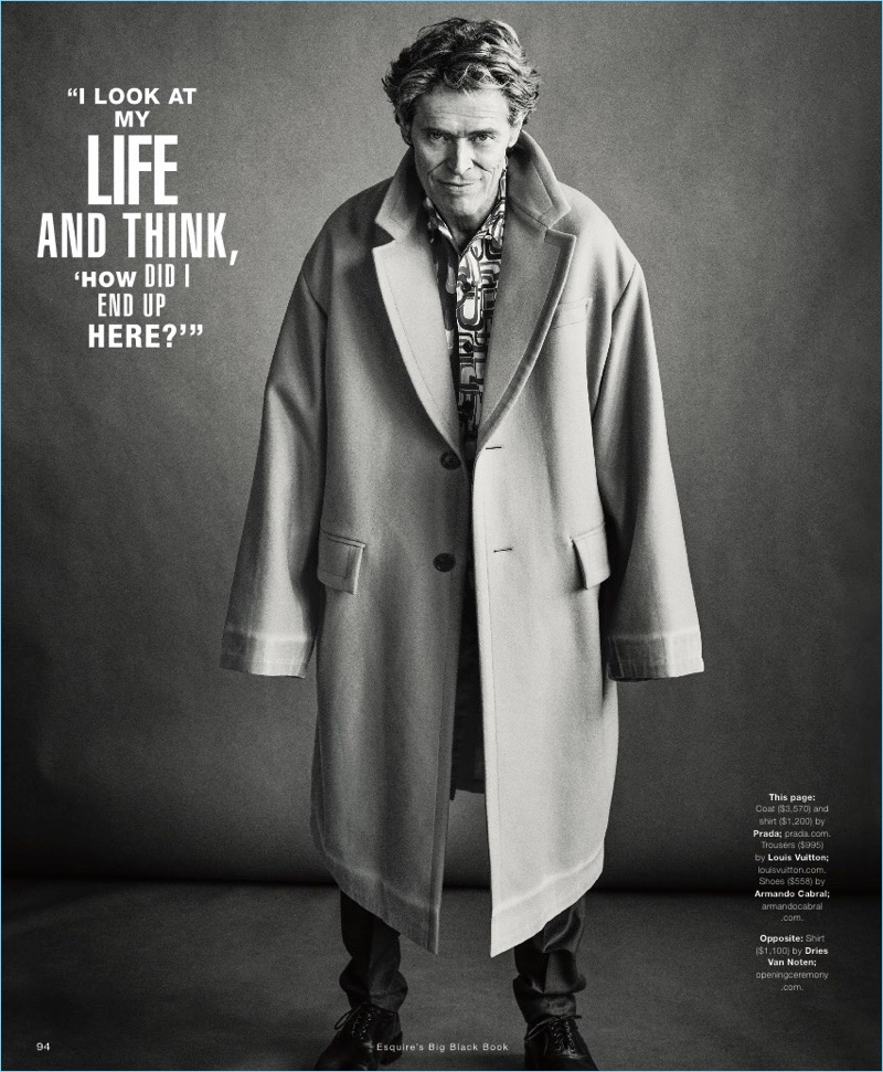 Embracing oversized style, Willem Dafoe dons a Prada coat and shirt. He also wears Louis Vuitton trousers and Armando Cabral shoes.