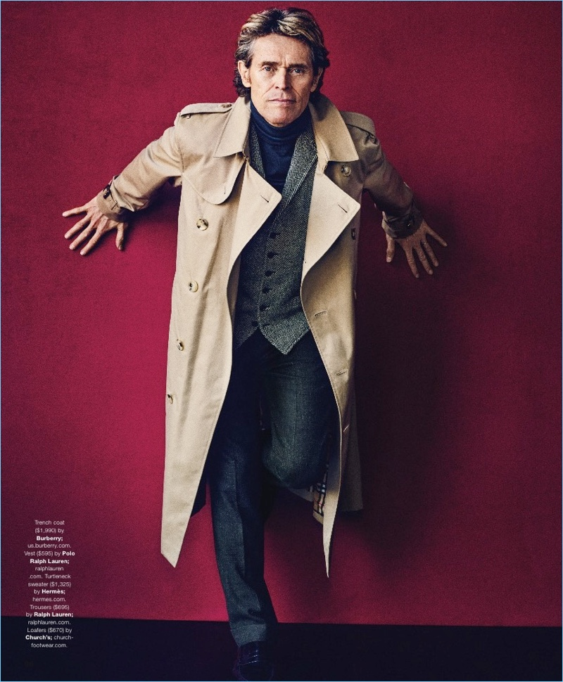 Front and center, Willem Dafoe wears a Burberry trench, POLO Ralph Lauren vest, Hermès turtleneck sweater, and Ralph Lauren trousers. Church's shoes complete Dafoe's look.