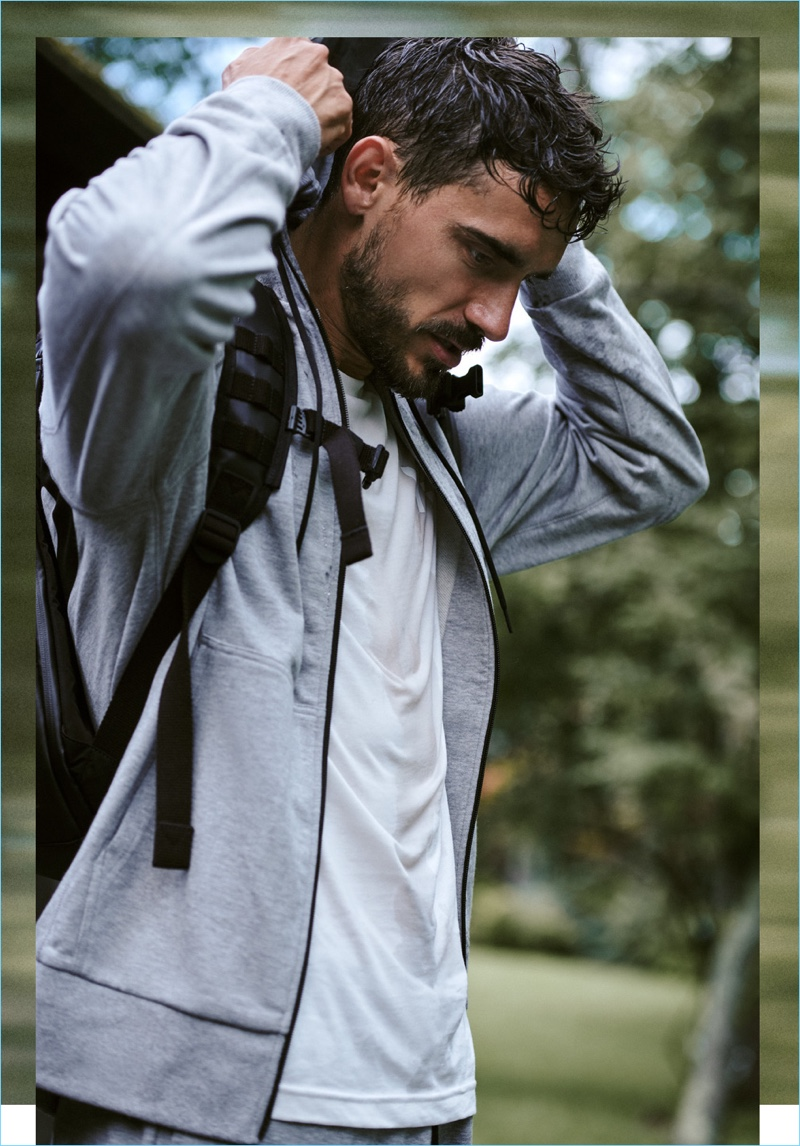 An active vision, Arthur Kulkov wears a Y-3 classic hoodie, tee, cuff pants, and mobility backpack.