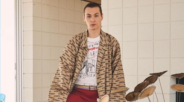 Embracing the oversized trend, Yuri Pleskun sports a Vetements car coat, logo sweatpants, and an Elephant Marta tee.
