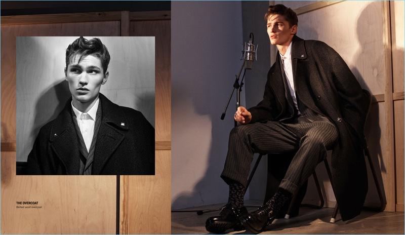 Sitting for a photo, Lukas Marschall wears a Zara Man overcoat.