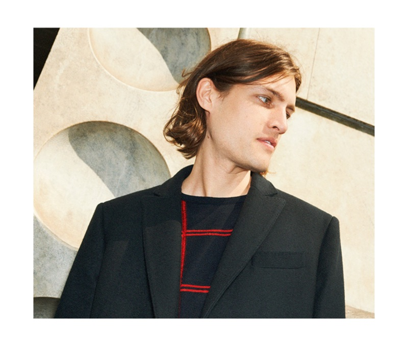 Canadian model Marcel Castenmiller wears a 8 by YOOX coat and graphic check sweater.