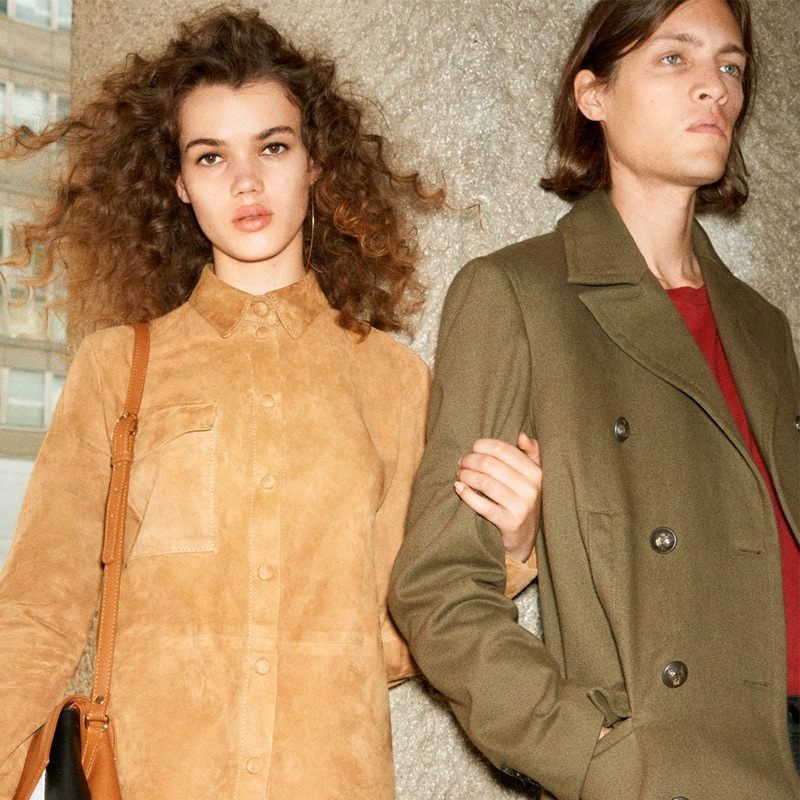 Models Hannah Sprehe and Marcel Castenmiller wear looks from 8 by YOOX. Marcel sports a military green coat from the range.