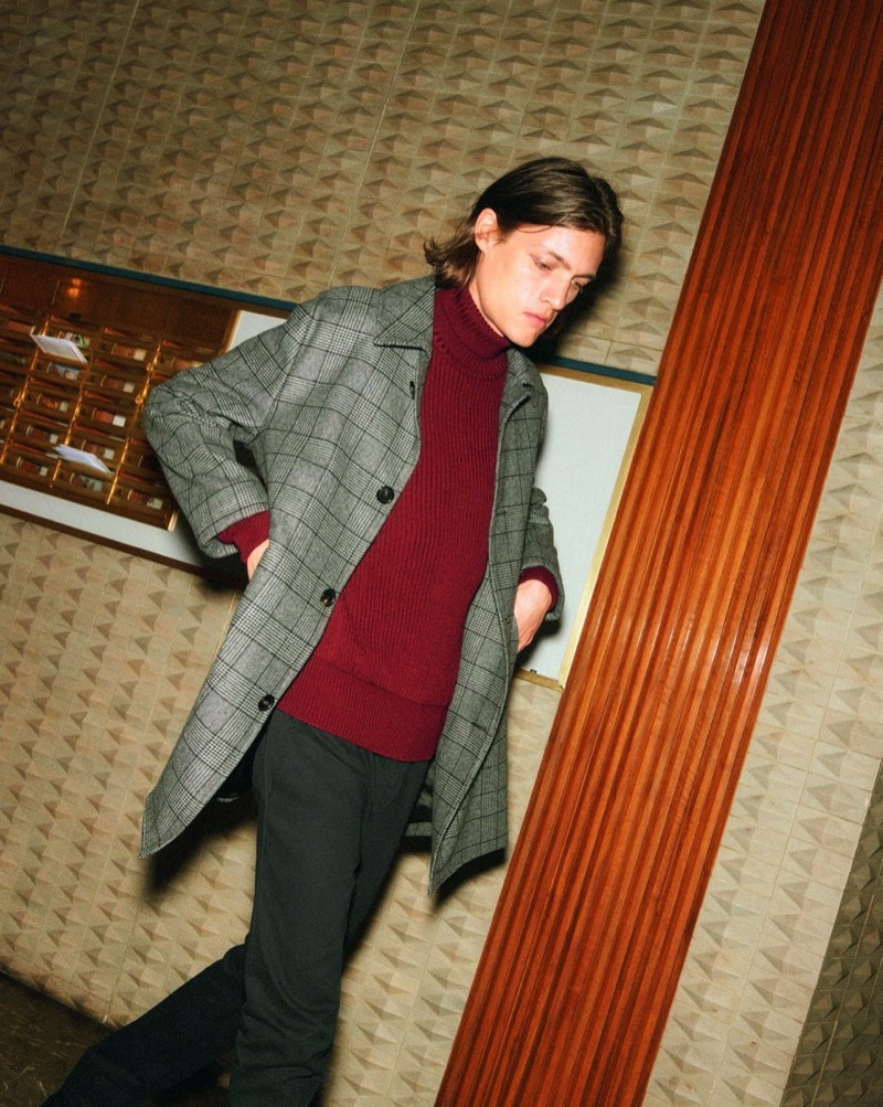 Marcel Castenmiller dons a 8 by YOOX ribbed turtleneck sweater and casual trousers.