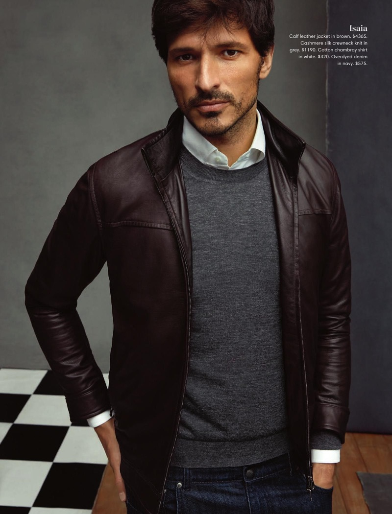 Andres Velencoso wears an ISAIA brown leather jacket with a cashmere sweater, chambray shirt, and denim jeans.