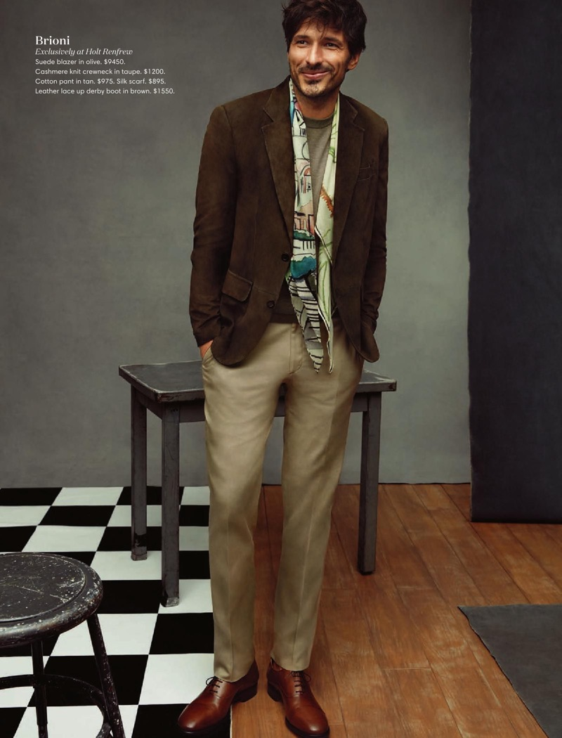 A smart vision, Andres Velencoso wears a Brioni suede blazer, cashmere sweater, tan pants, and leather shoes.