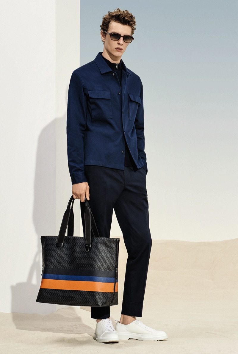 Tim Schuhmacher sports a navy and black look from BOSS' spring-summer 2019 collection.