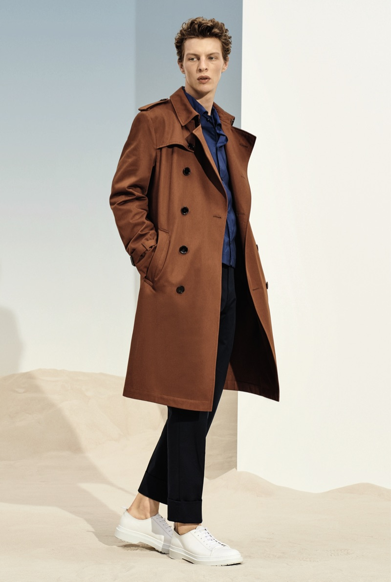 Donning a brown trench coat, Tim Schuhmacher appears in BOSS' spring-summer 2019 lookbook.