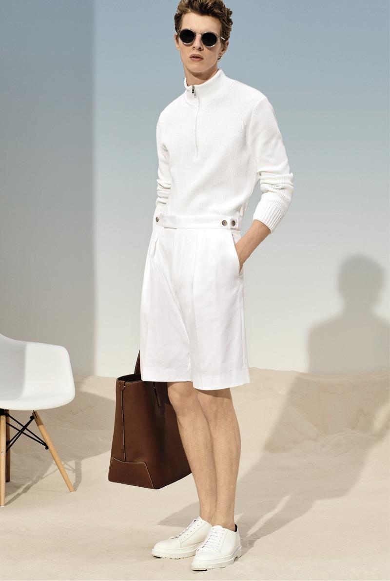 Ready for summer, Tim Schuhmacher wears a white look from BOSS.