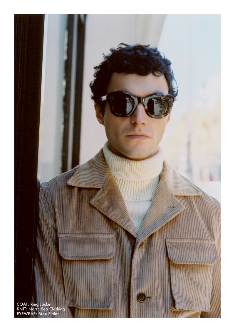 Reuniting with Beige, Dylan Ézékiel Nelson dons a corduroy coat by Ring Jacket with a North Sea Clothing turtleneck sweater and Max Pittion sunglasses.