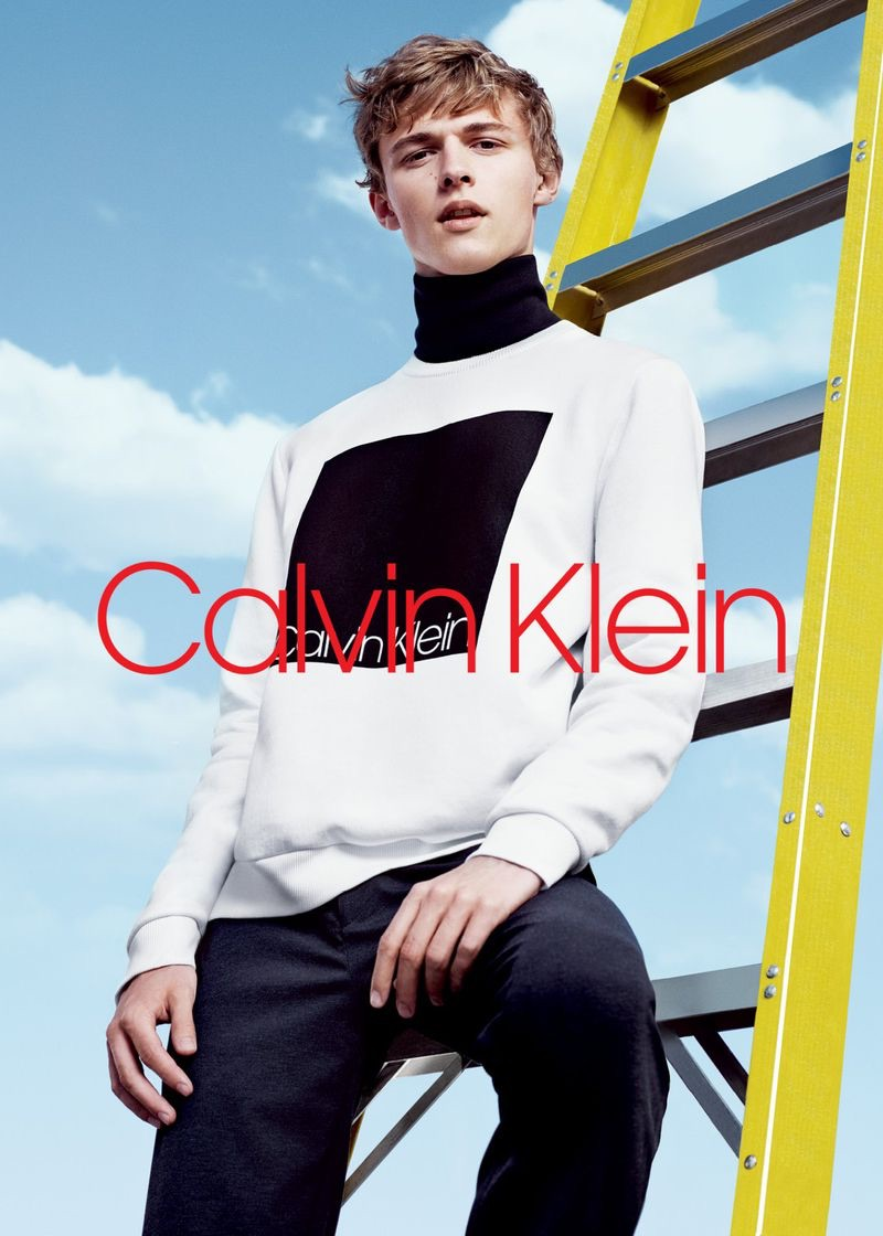 Sporting a black turtleneck and logo sweatshirt, Max Barczak fronts Calvin Klein's fall-winter 2018 men's campaign.