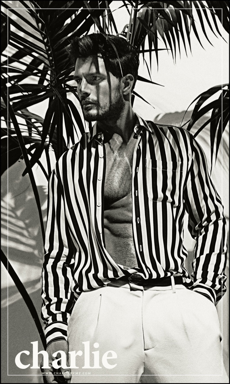 Diego Miguel sports a striped shirt from Charlie by Matthew Zink's resort 2018 collection.
