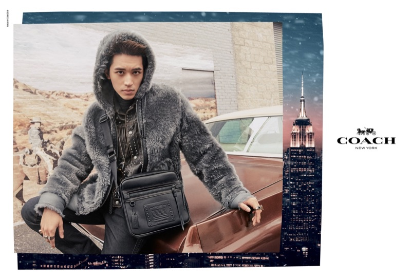 Timmy Xu dons a reversible shearling hoodie in dark grey for Coach's holiday 2018 campaign.