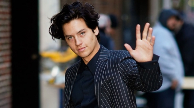 October 2018: Cole Sprouse wears a Versace pinstripe suit in New York City.