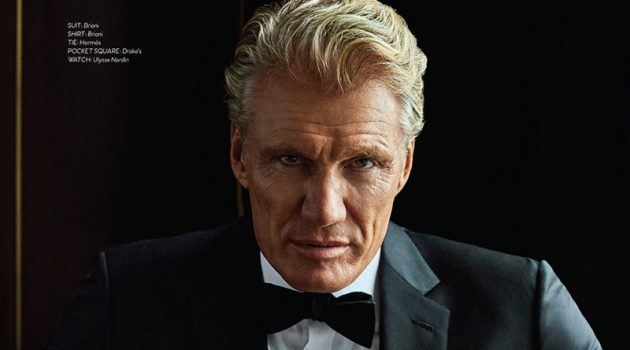 Donning a Brioni tuxedo and shirt, Dolph Lundgren also wears a Hermès bow-tie, Drake's pocket square, Bruno Magli boots, and an Ulysse Nardin watch.