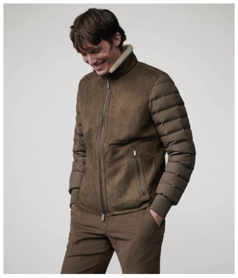 All smiles, Michael Gandolfi dons a brown look from Ermenegildo Zegna.