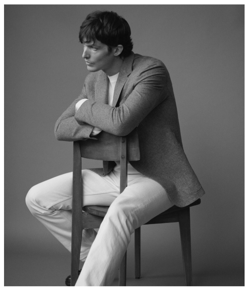 Sitting for a portrait, Michael Gandolfi wears Ermenegildo Zegna.