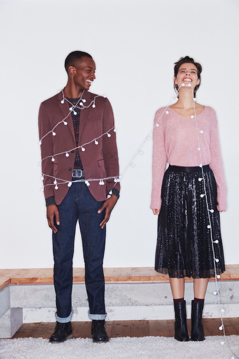 All smiles, Oliver Kumbi and Margot Davy front Esprit's holiday 2018 campaign.