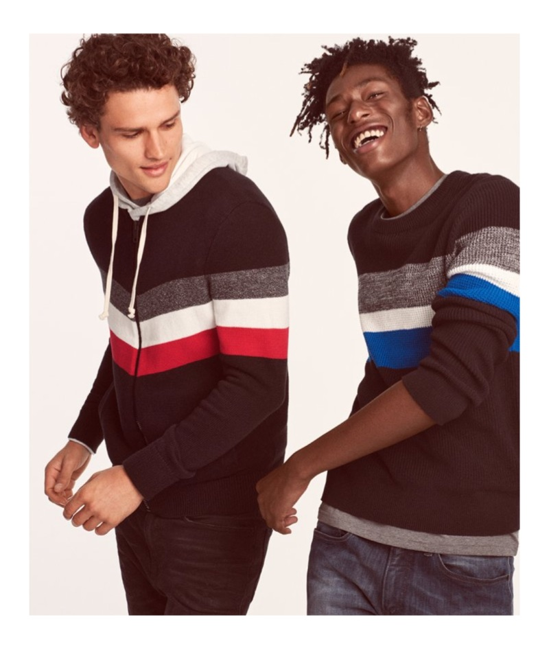 Models Simon Nessman and Shenai Gist sport color blocked sweaters from Express.