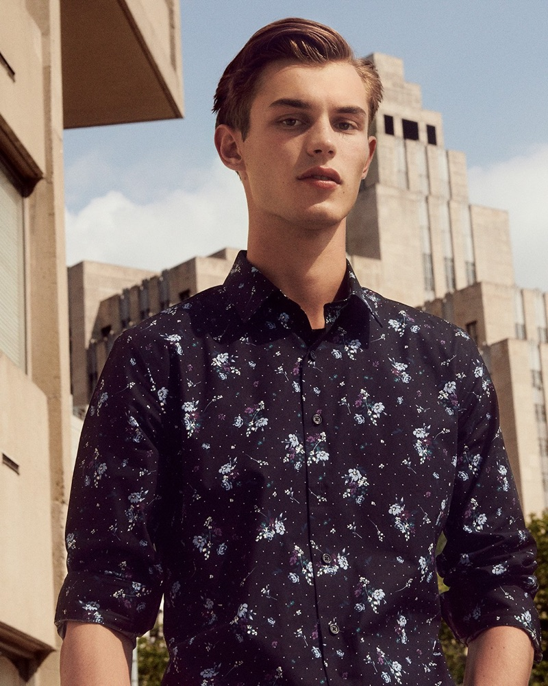 British model Kit Butler wears a slim-fit floral print dress shirt from Express.