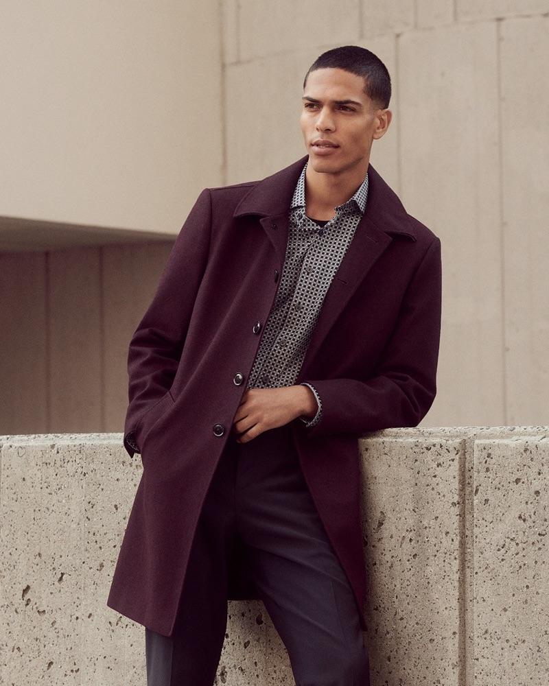Geron McKinley wears a sleek burgundy recycled wool-blend topcoat by Express.