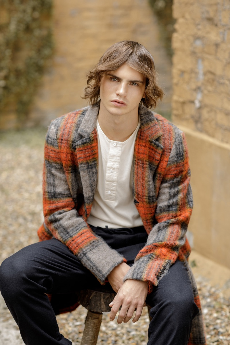 Kit wears checked coat Scotch & Soda, henley Lee Cooper, and trousers You Must Create.