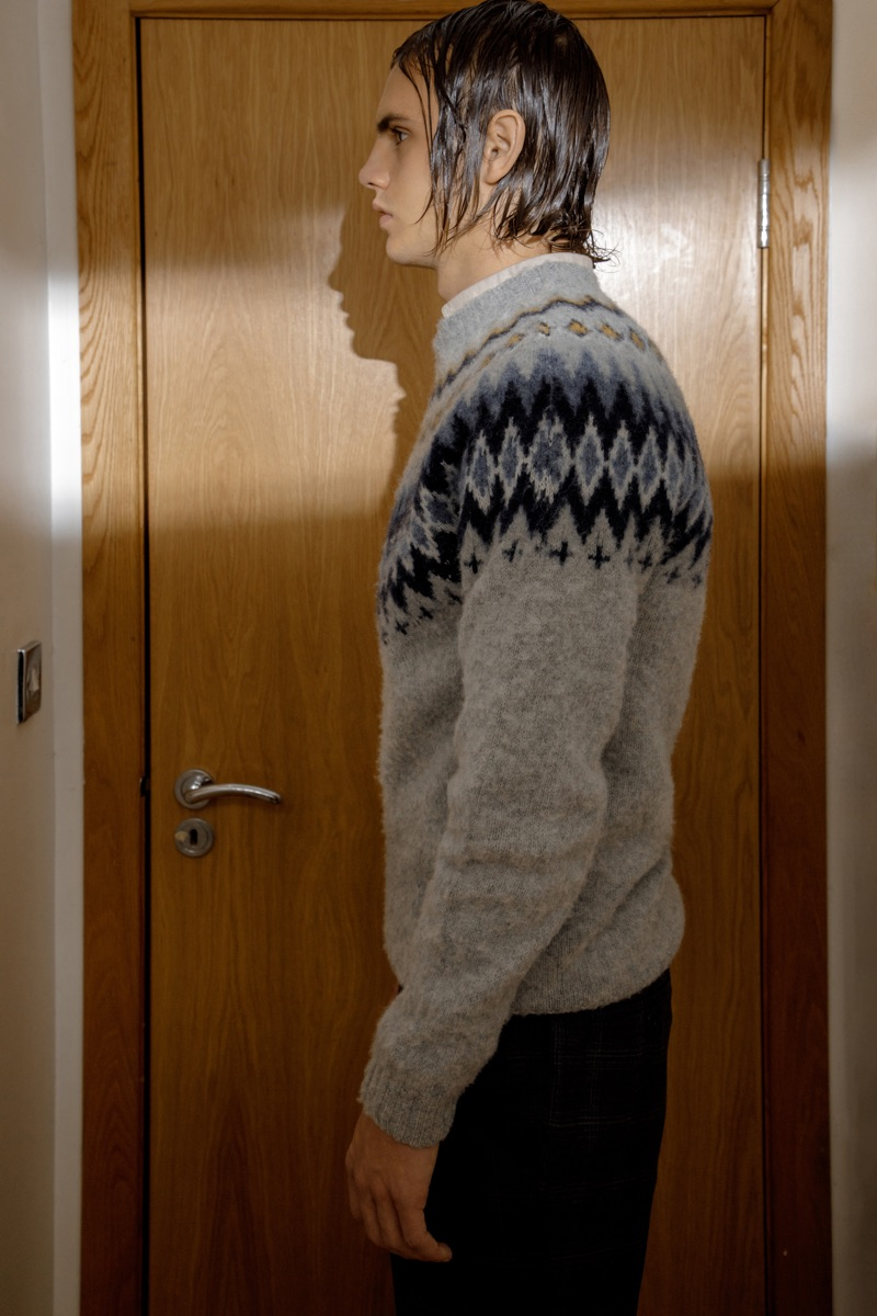 Kit wears sweater Norse Projects, shirt Filippa K, and trousers Simon Carter.