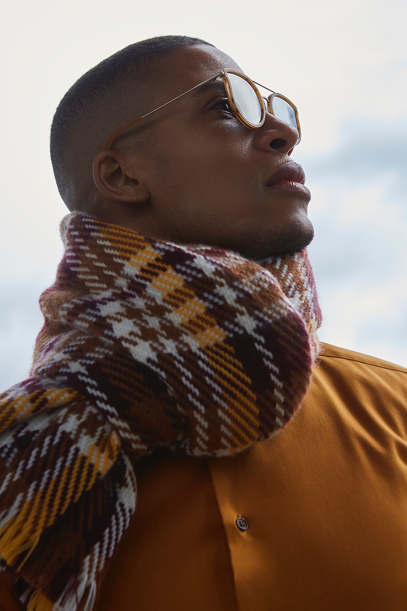 Vincent wears shirt Eterna, scarf Reserved, and sunglasses Kerbholz.