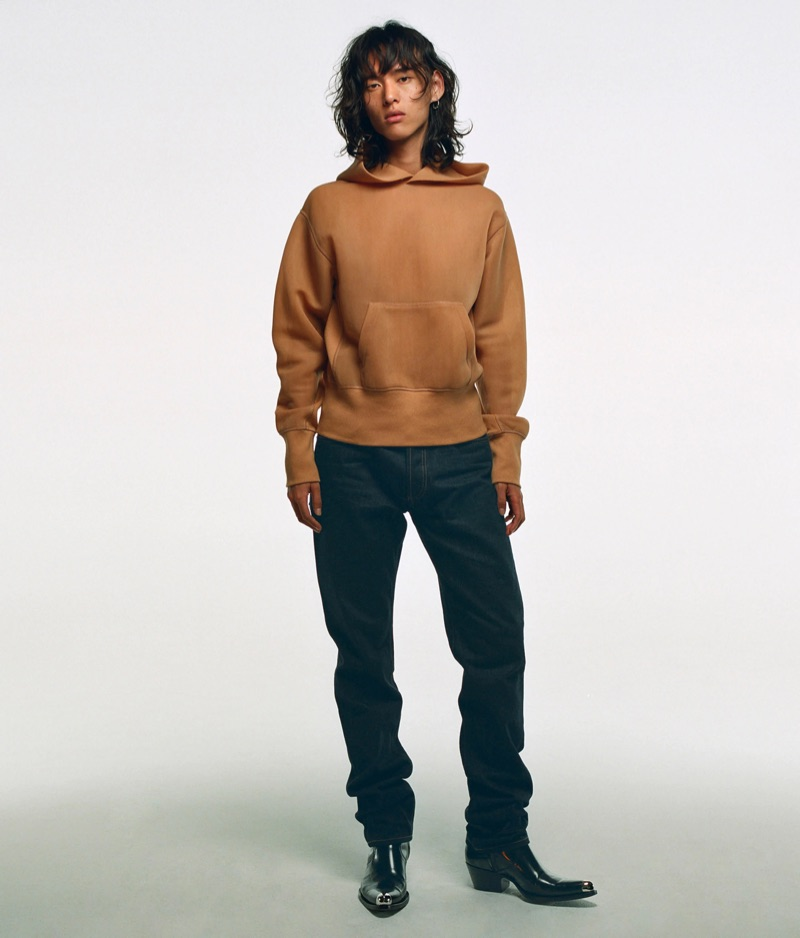 Going casual, David Yang wears a hoodie from Helmut Lang.