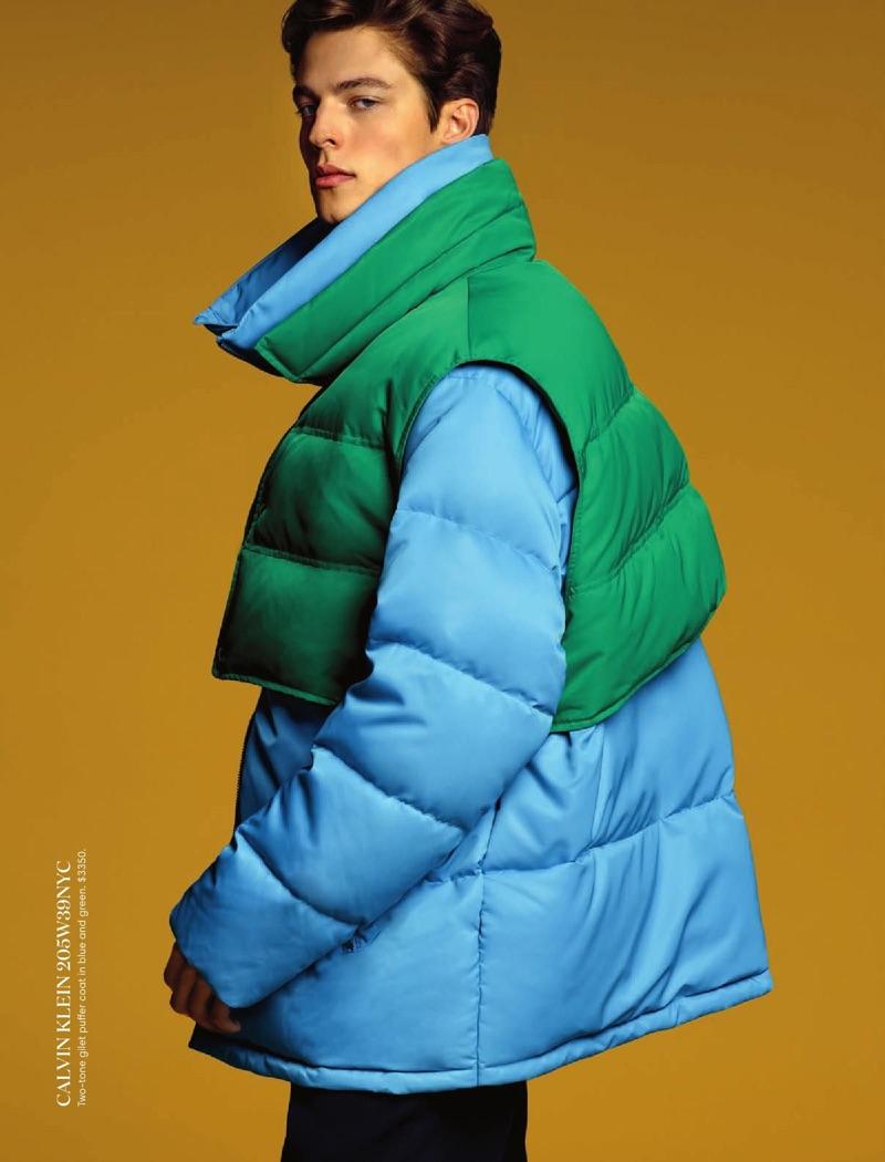 Brodie Scott sports a puffer jacket from Calvin Klein.