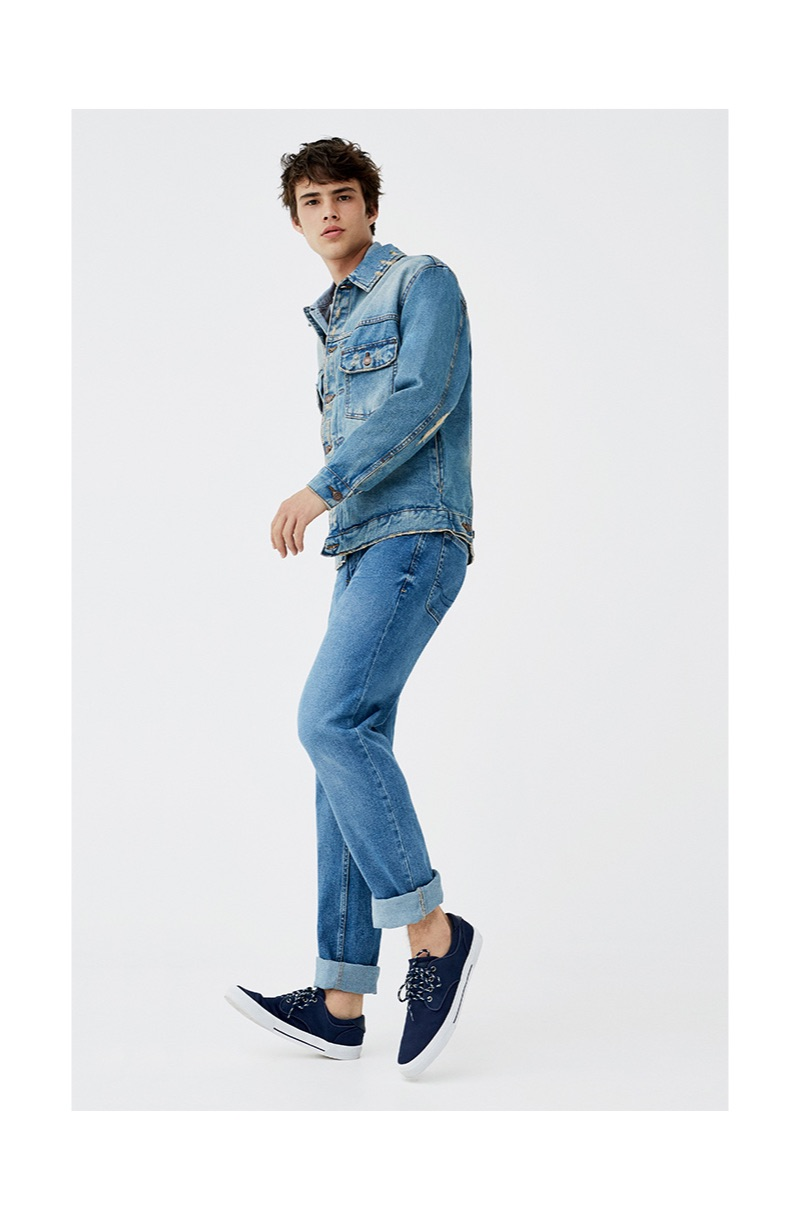 Doubling down on denim, Louis Baines sports a jeans jacket and overalls.