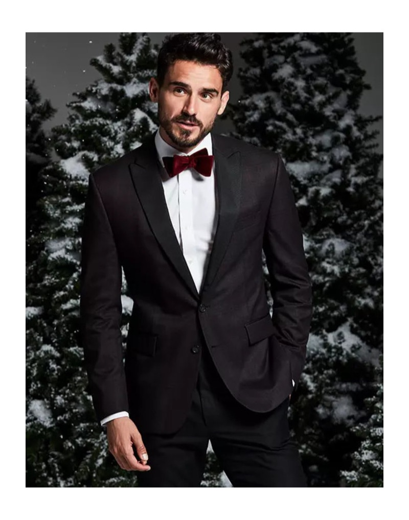 Winter Wedding: Arthur Kulkov is dashing in a Ryan Seacrest Distinction burgundy check dinner jacket and velvet bow-tie.