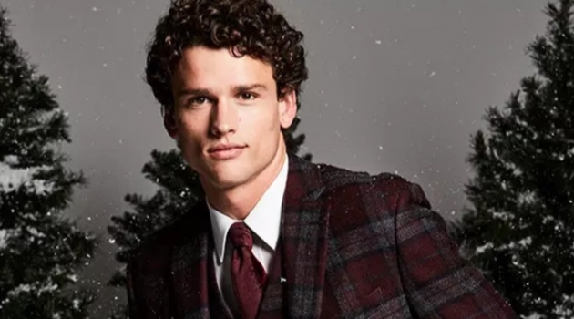 Christmas Dinner: Embracing checks, Simon Nessman sports a Lauren by Ralph Lauren classic-fit tartan plaid wool sport coat and vest. He also dons a clean white dress shirt.