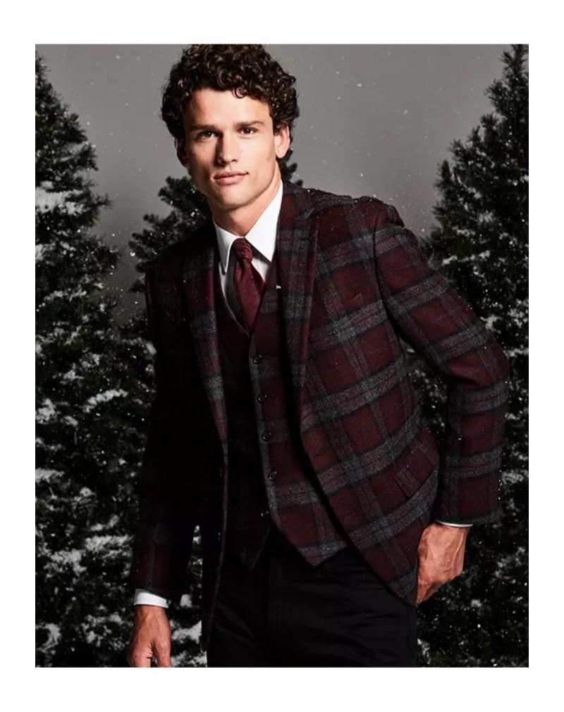 Christmas Dinner: Embracing checks, Simon Nessman sports a Lauren by Ralph Lauren classic-fit tartan plaid wool sport coat and vest. He also dons a clean white dress shirt.