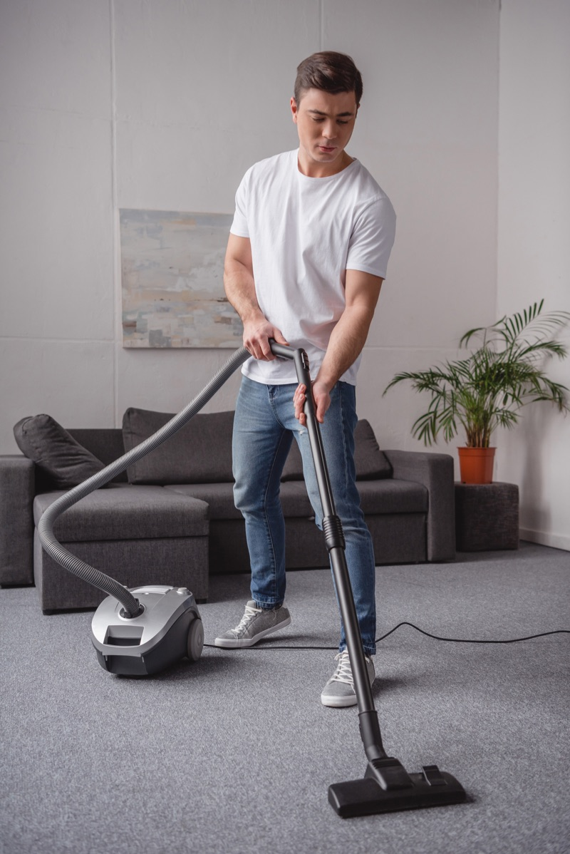 Man Cleaning Home Vacuum