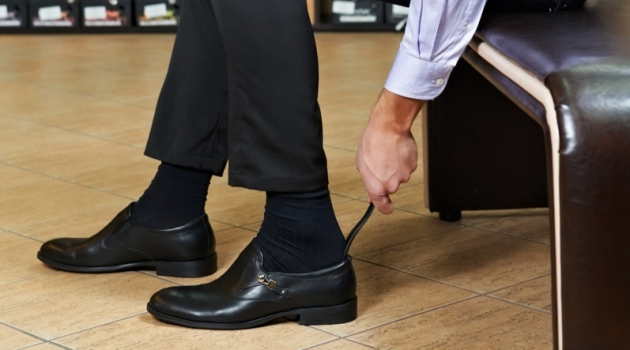 Man in Store Trying on Shoes