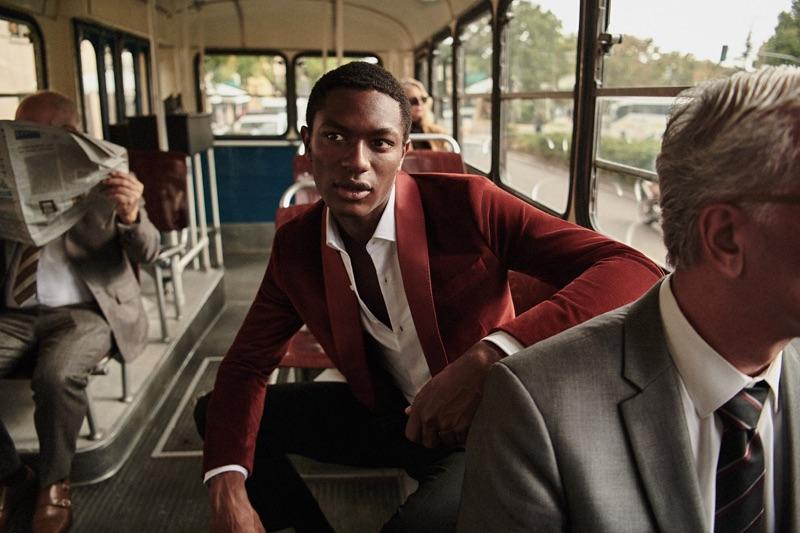 Hamid Onifade sports a velvet jacket for Mango Man's holiday 2018 campaign.