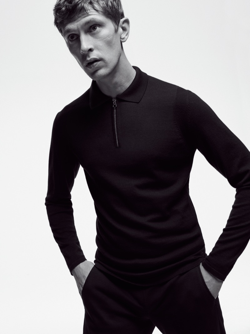 Top model Mathias Lauridsen dons a long-sleeve polo and pants from Marc O'Polo's Black Fashion Week capsule collection.