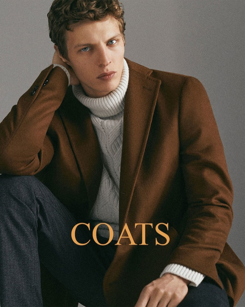 A chic vision, Tim Schuhmacher  dons a brown coat for Massimo Dutti's holiday 2018 gift guide.