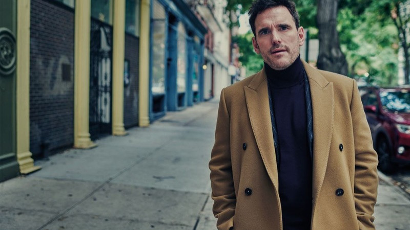 Matt Dillon dons a Salle Privée double-brested coat with a Man 1924 suit jacket and Brioni cashmere turtleneck sweater.