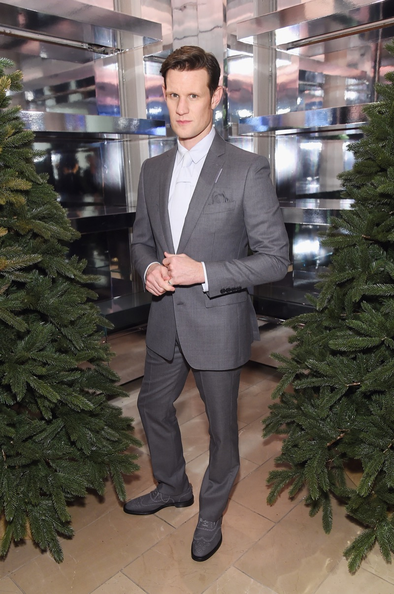 Matt Smith dons a grey suit from Burberry.